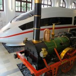 Germany's oldest train engine is dwarfed by a new ICE engine at the Deutsche Bahn Museum, Nuremberg